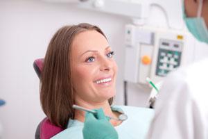 Female patient visitng a dentist for immediate dentures