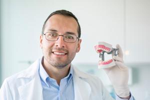 Dentist Holding Teeth